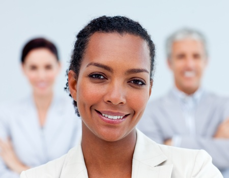 Multi-ethnic business people standing with folded arms  photo