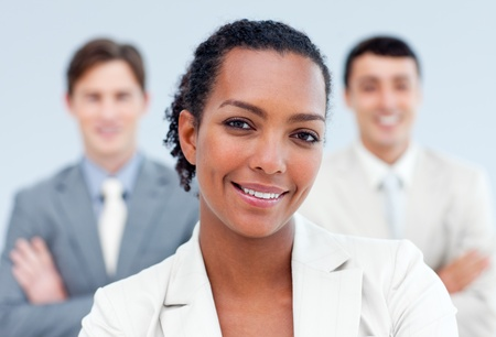 Positive business partners standing with folded arms photo