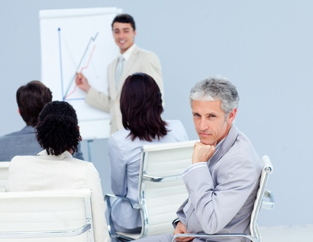 Confident businessman looking at the camera at a conference photo