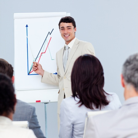 Positive young businessman doing a presentation photo
