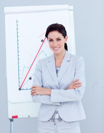 globalization: Elegant businesswoman giving a presentation Stock Photo