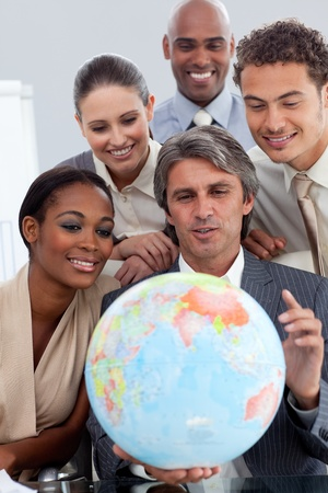 Visionary business people smiling at global business expansion  photo