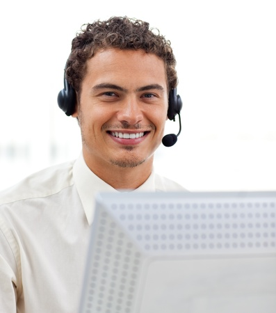 Latin young businessman with headset on  photo