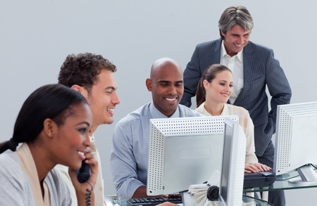 teaming: Confident business team at work