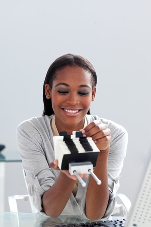 Afro-american businesswoman holding a business card holder  photo