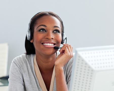 Afro-american businesswoman using headset  photo
