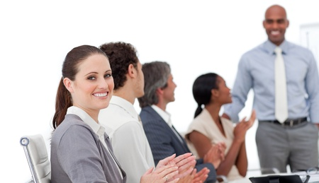 Positive business people clapping a good presentation  photo