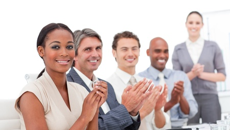 A diverse business group applauding a good presentation photo