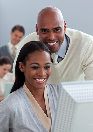 Portrait of two enthusiastic businesspeople working at a computer Stock Photo - 10095364