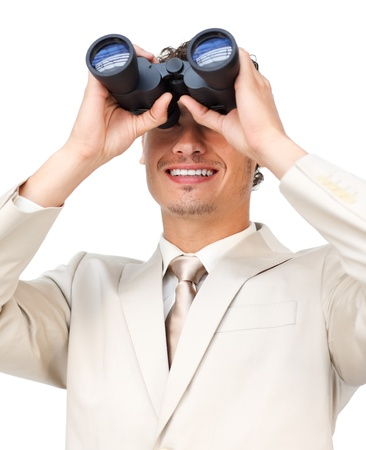 Visionary businessman looking through binoculars  photo