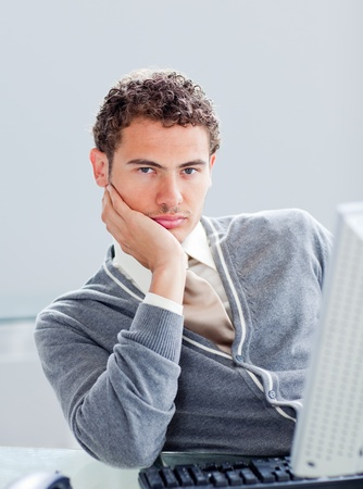 Portrait of a young businessman getting bored at work Stock Photo - 10112114
