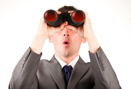 Young businessman looking through binoculars photo