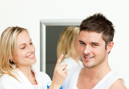 Happy man with cream in his nose with her girlfriend Stock Photo - 10093280