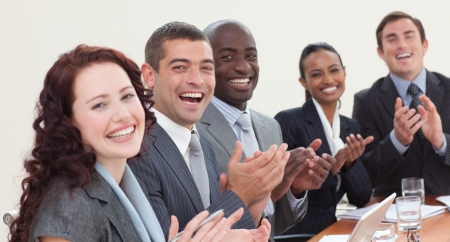 applauding: Happy business team laughing and clapping