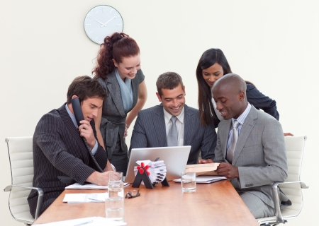 Group of people working in a business meeting photo