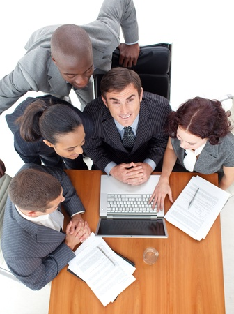 Businessteam working with their boss with a laptop Stock Photo - 10108631