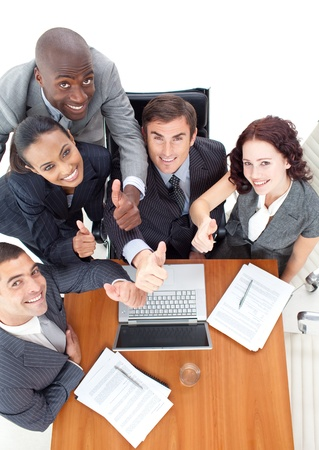 High view of business team with thumbs up working together with a laptop Stock Photo - 10109087