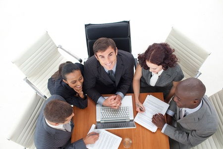 Businessteam working together with a laptop Stock Photo - 10108382