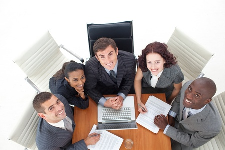 High view of business people working with a laptop  Stock Photo - 10108387