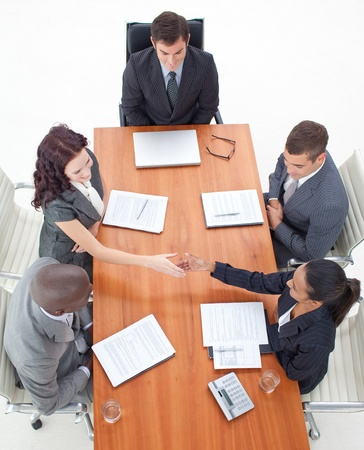 High angle of businesswomen shaking hands in a meeting Stock Photo - 10108414
