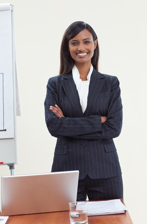 Confident ethnic businesswoman in office photo