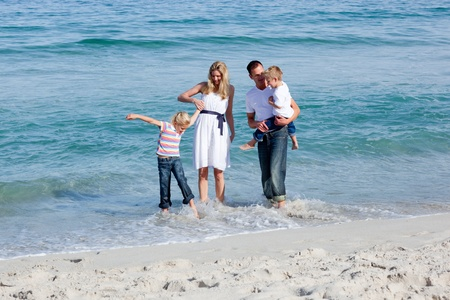 Lively family having fun at the beach photo