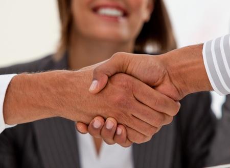 Close-up of successful businessmen closing a deal photo