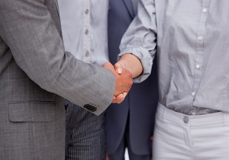 stipulation: Close-up of a victorious businessteam closing a deal Stock Photo