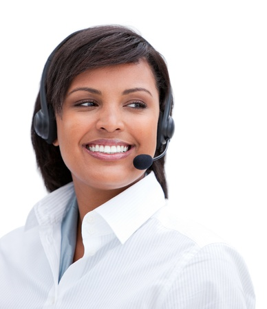 Portrait of a smiling businesswoman with headset on   photo