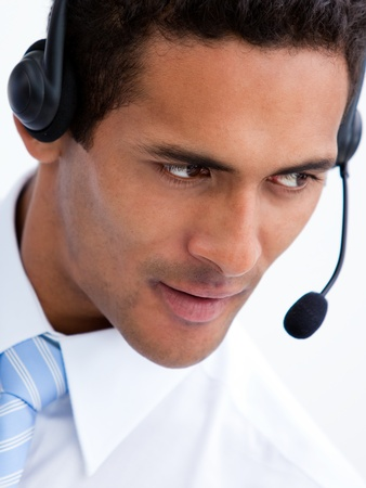 Portrait of a positive businessman with headset on photo