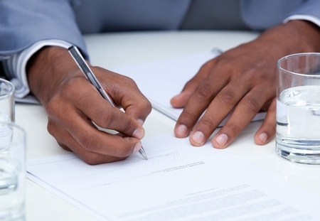 stipulation: Close-up of ambitious business man signing a contract Stock Photo