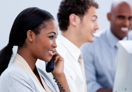 Positive Afro-American businesswoman talking on phone photo
