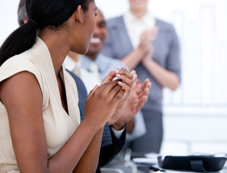 Happy business team applauding in a meeting photo