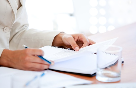 Close-up of a businessman studying a contract photo