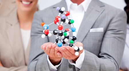 Close-up of a businessman holding a molecule  Stock Photo - 10092820