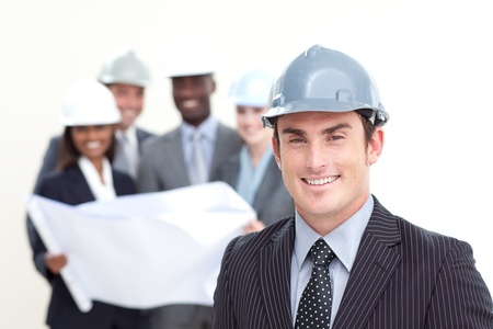 Engineer looking at his team in the background photo