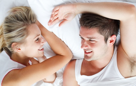 Couple relaxing in bed photo