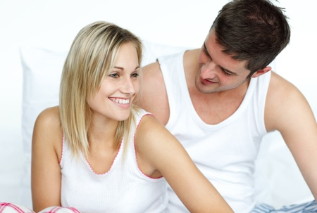 Lovers together sitting on bed Stock Photo - 10092936