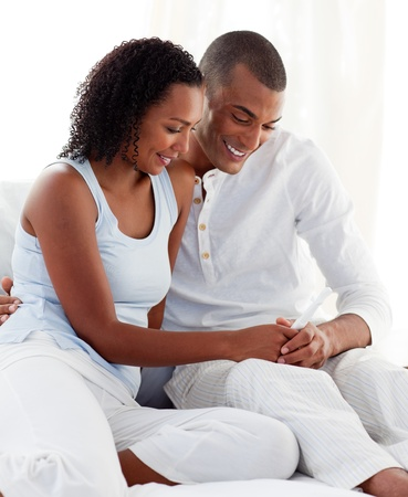 finding out: Afro-american couple finding out results of a pregnancy test
