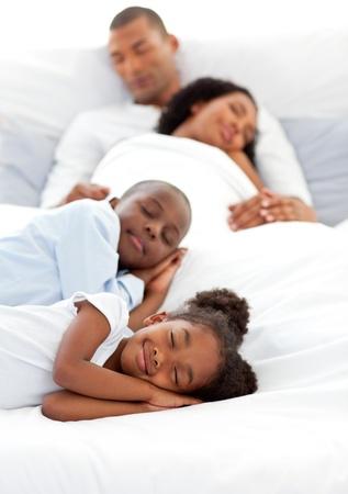 Happy family sleeping photo