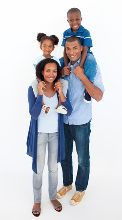 Family giving children piggyback ride  photo
