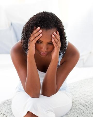Afro-amrican woman having a headhache photo