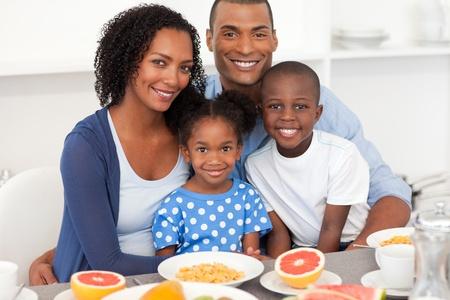 Happy family having healthy breakfast photo