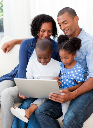 Happy family using a laptop photo