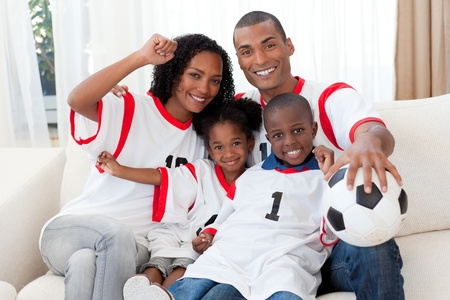 Afro-American family celebrating a football goal photo