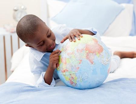 Small boy looking at a Globe photo