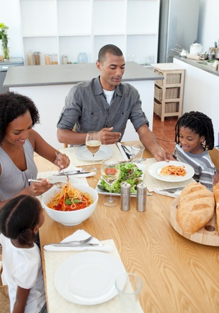 Loving family dining together photo