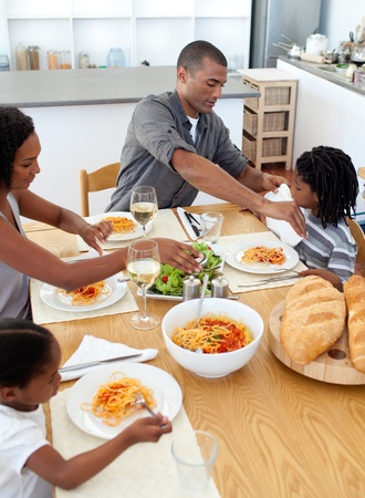 Cheerful family dining together Stock Photo - 10112810