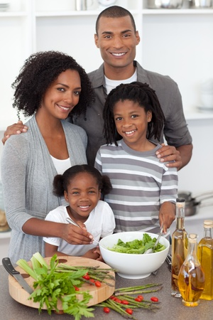 Afro-american family preparing salad together photo