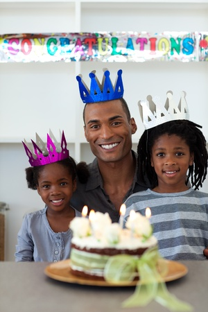 Joyful Afro-american father with his children celebrating a birthday  photo